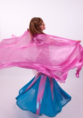 Dancer in swirling pink and blue outfit